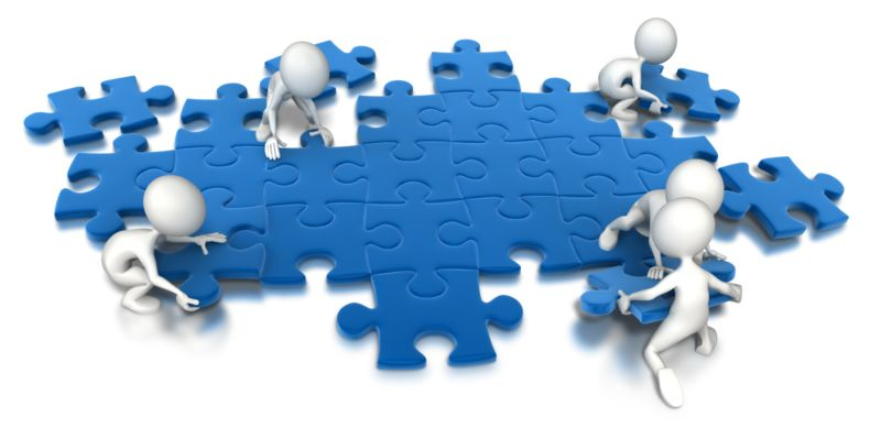 Clipart - Puzzle People Working Together