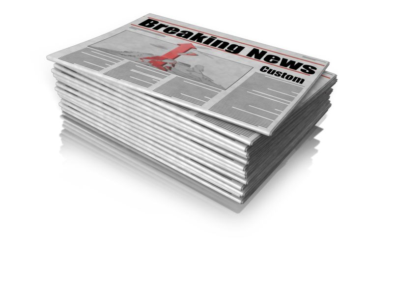 This clip art shows a stack of news paper where you can make your own headline.