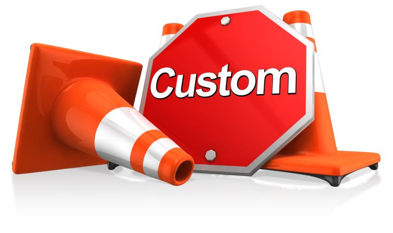 This clipart shows a stop sign leaning against traffic cones. The stop sign can be used for custom text.