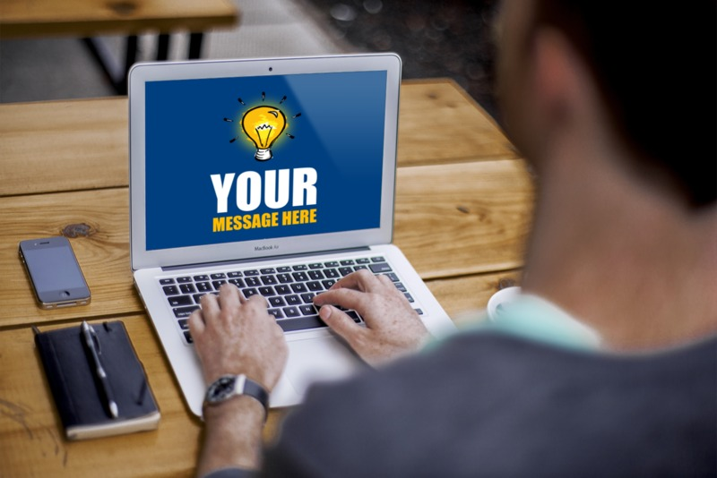 This Presentation Clipart shows a preview of Man Sitting On Laptop