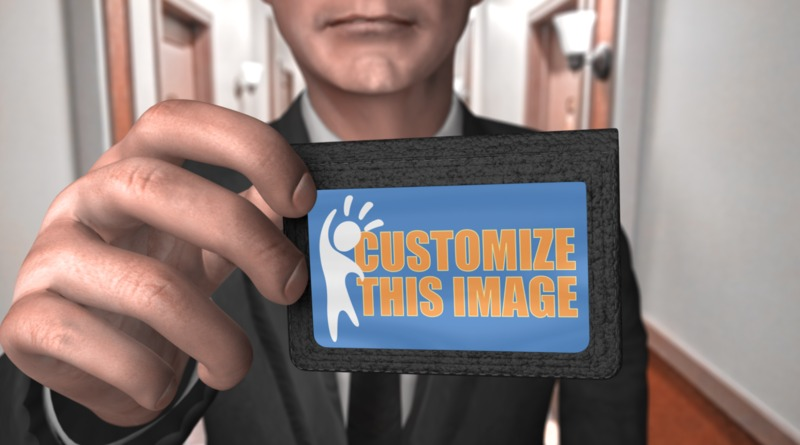 A man in a suit holds up an ID with your custom design on it.