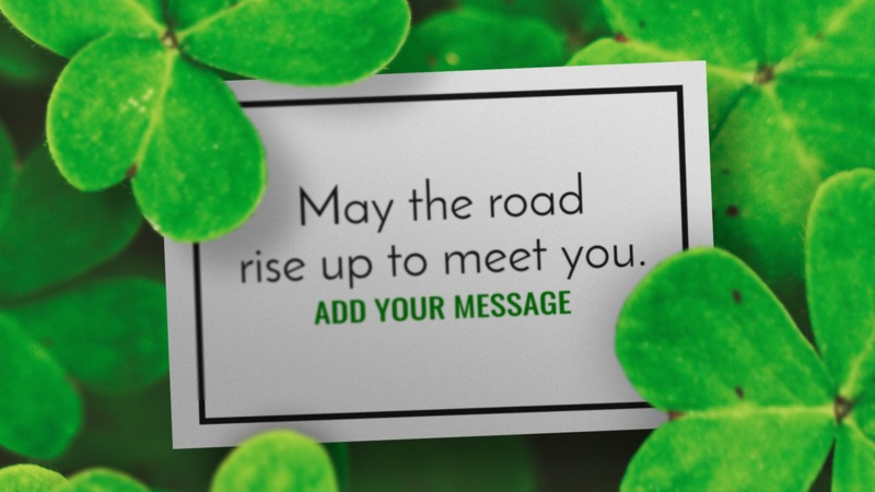 A close up of a card in a field of clover. You may add your own message to the card using our on-line tools.
