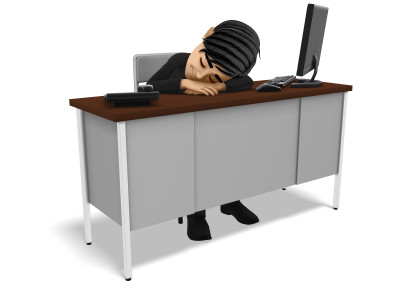 A image of a man with no motivation sleeping at a work desk.